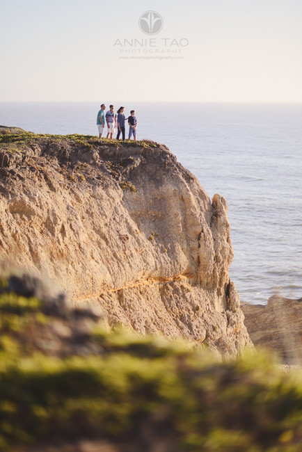 Bay-Area-lifestyle-family-photography-family-of-four-standing-on-cliff-during-sunset