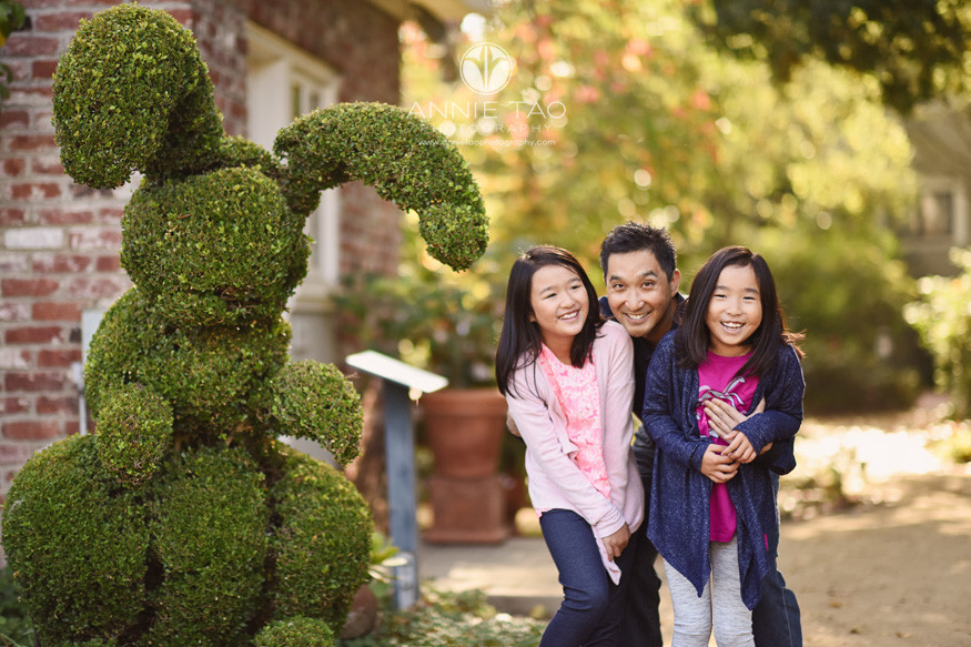 Bay-Area-lifestyle-family-photography-father-hugging-daughters-by-giant-rabbit-bush