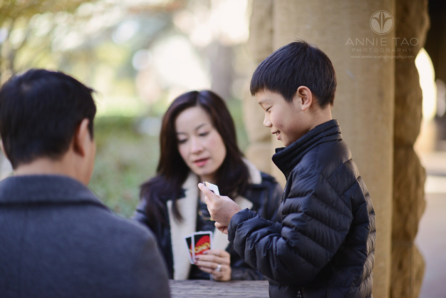 Bay-Area-Palo-Alto-family-photography-boy-smiling-while-playing-Uno