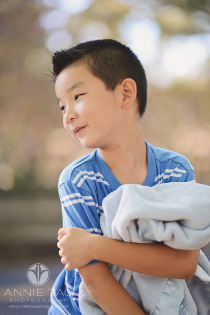 East-Bay-lifestyle-children-photography-young-boy-hugging-blue-lovey-blanket
