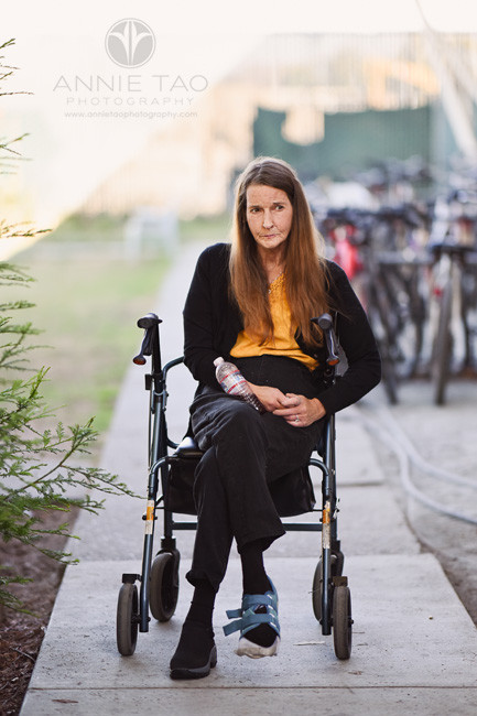 san-francisco-bay-area-commercial-photography-lifemoves-pensive-woman-sitting-on-walker-outdoors