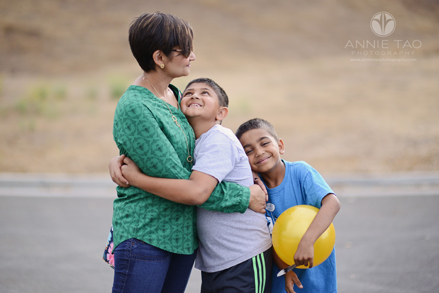 East-Bay-lifestyle-family-photography-boys-hugging-their-mom-in-parking-lot