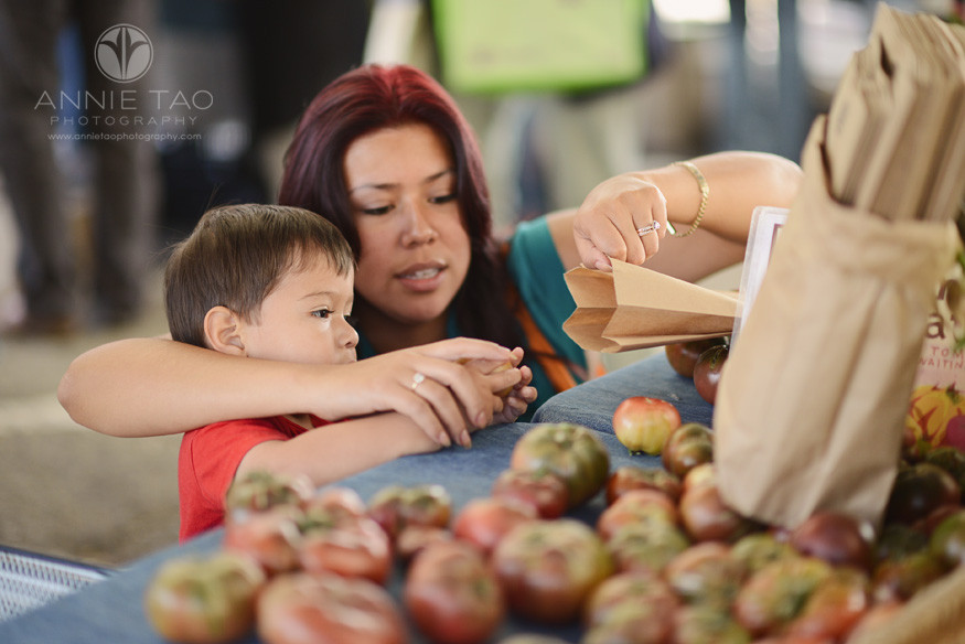 East-Bay-Commercial-Photography-mother-helping-her-son-bag-produce-at-Berkeley-farmers-market