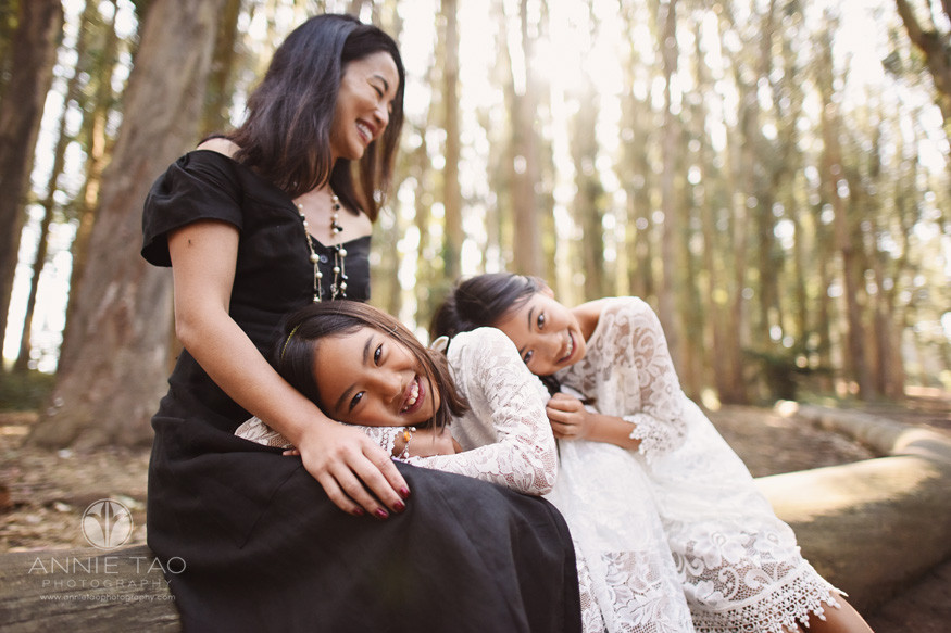 San-Francisco-lifestyle-family-photography-daughters-laying-on-mothers-lap-in-woods