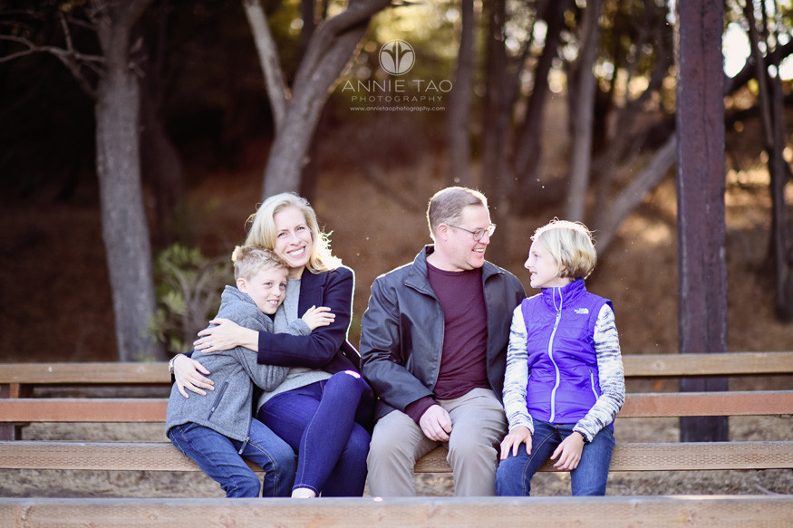 South-Bay-lifestyle-family-photography-happily-sitting-on-benches-in-morning-sun