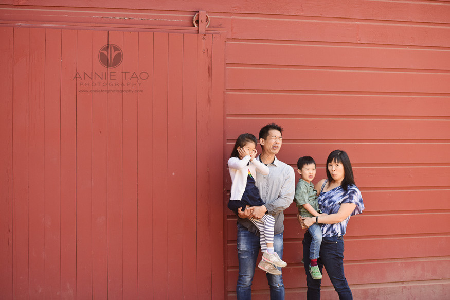 Bay-Area-lifestyle-family-photography-making-funny-faces-by-red-barn