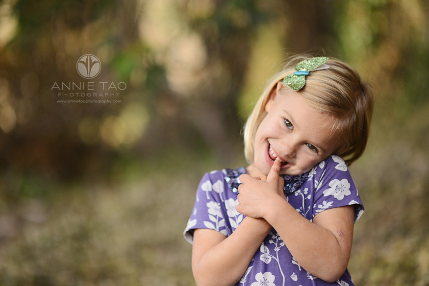 San-Francisco-lifestyle-children-photography-young-girl-smiling-with-hands-at-face