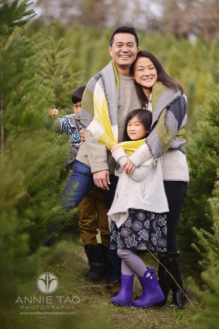 bay-area-lifestyle-photography-family-hugging-in-tree-farm
