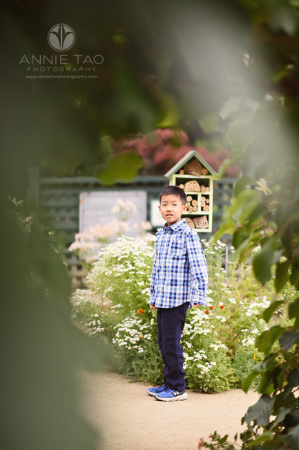 Bay-Area-lifestyle-children-photography-young-boy-peering-into-tunnel-of-vines