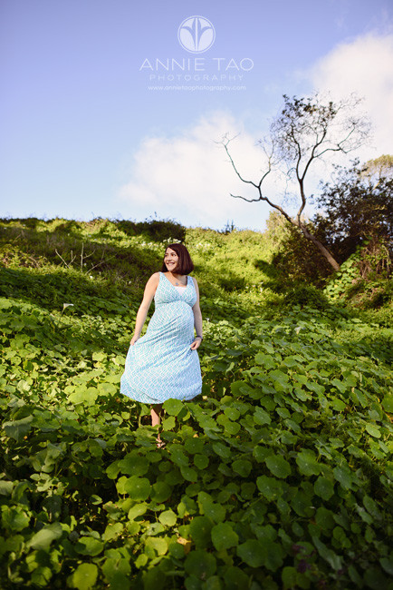 San-Francisco-lifestyle-maternity-photography-pregnant-woman-twirling-in-hilly-field-of-callalilies