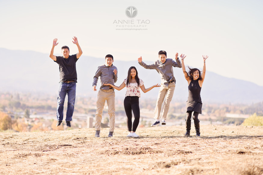 South-Bay-lifestyle-teen-young-adult-family-photography-jumping-on-tall-hill