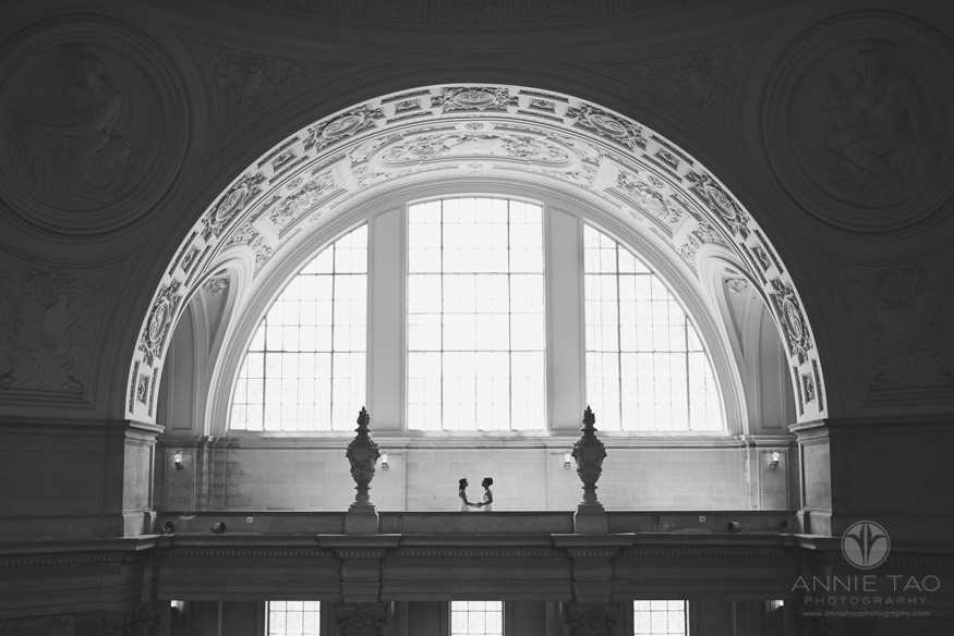 San-Francisco-wedding-photography-City-Hall-gay-wedding-brides-facing-each-other-shot-from-distance-BxW