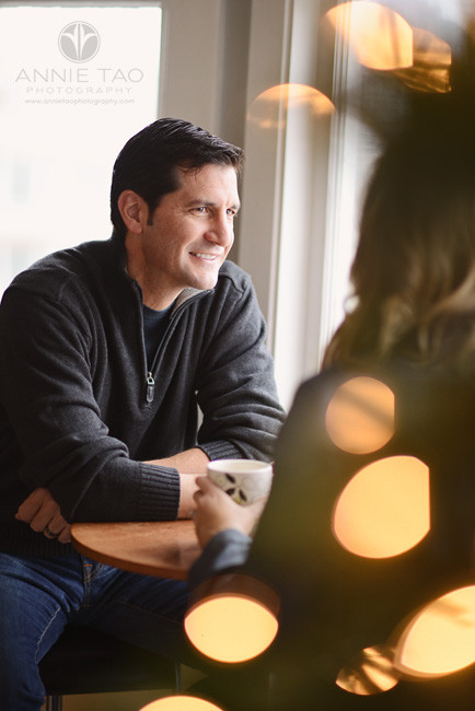 San-Francisco-couple-lifestyle-photography-man-gazing-at-his-wife-by-a-bay-window