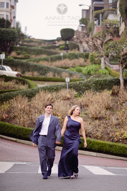 San-Francisco-couple-styled-photography-man-and-woman-in-blue-formal-attire-crossing-Lombard-Street