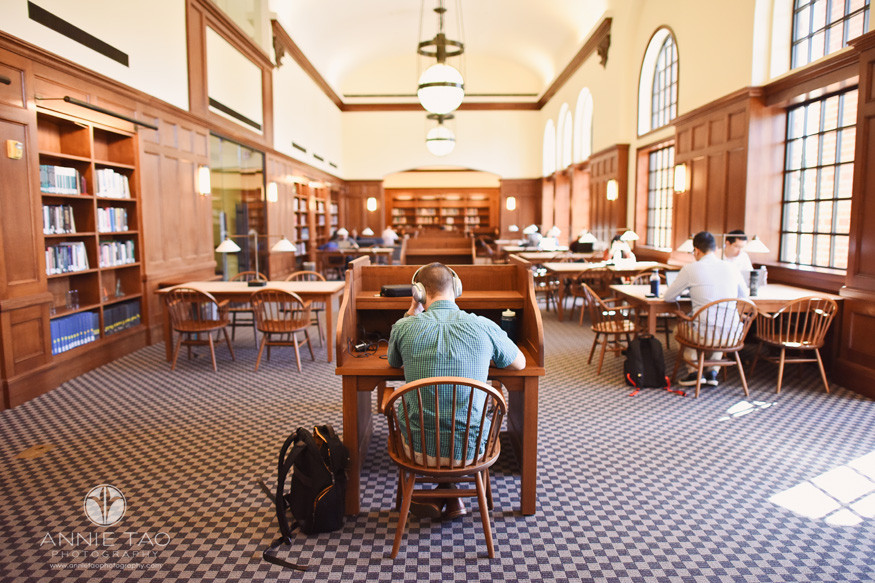Commercial-Photography-Rice-Business-School-male-student-studying-at-library-with-headphones