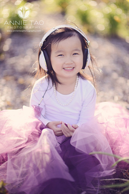 East-Bay-styled-children-photography-preschooler-listening-to-music-with-a-headset-closeup