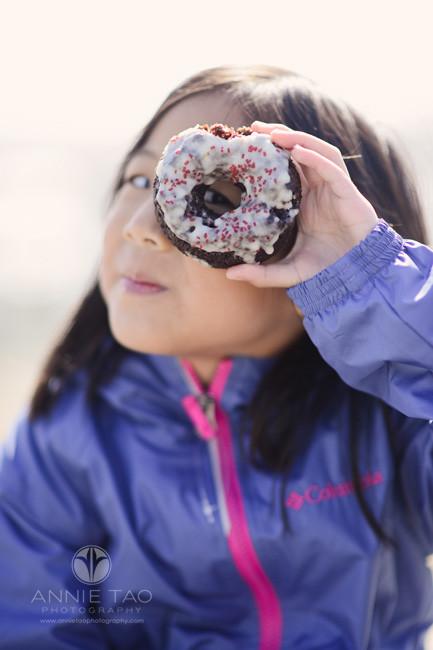 San-Franciso-lifestyle-children-photography-girl-peeking-through-donut-hole