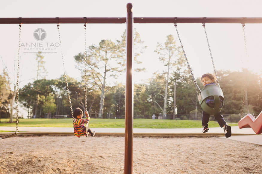 east-bay-lifestyle-children-photography-young-kids-turning-around-on-swings-at-dusk