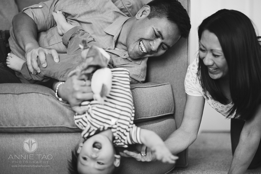 South-Bay-lifestyle-baby-photography-parents-catching-baby-thrusting-off-couch-BxW