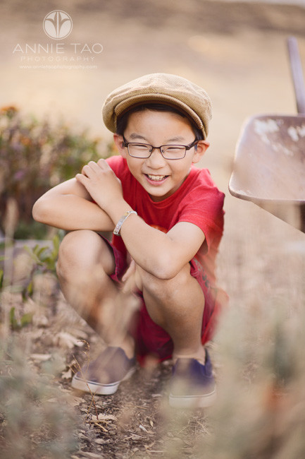 east-bay-styled-children-photography-squatting-boy-in-red-laughing