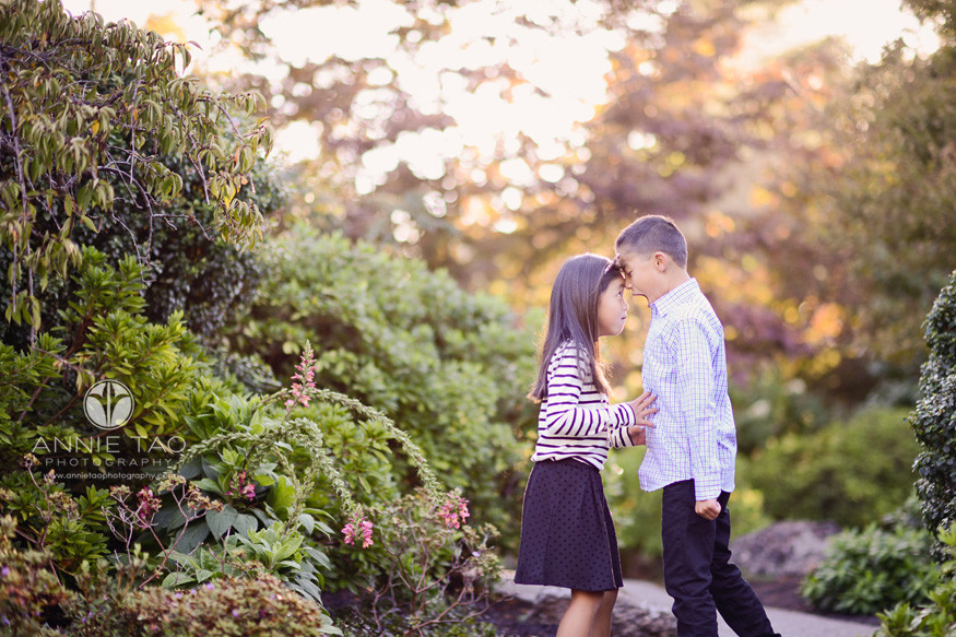 East-Bay-lifestyle-children-photography-brother-and-sister-heads-touching-in-garden