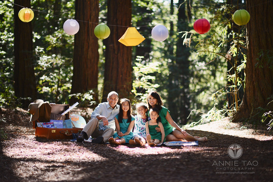 East-Bay-styled-family-photography-family-sitting-under-paper-lanterns-in-woods