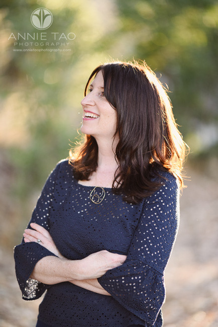 East-Bay-lifestyle-photography-smiling-woman-in-navy-with-arms-folded