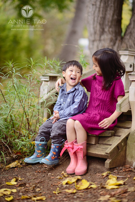 Los-Altos-lifestyle-children-photography-toddler-boy-laughing-while-big-sister-sits-with-him