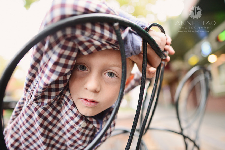 Bay-Area-lifestyle-children-photography-young-boy-looking-through-wired-chair-back