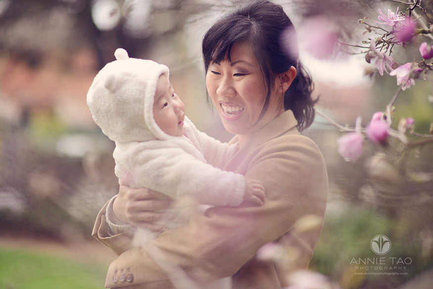 Bay-Area-Palo-Alto-lifestyle-family-photography-mom-laughing-with-baby-through-japanese-cherry-blossoms