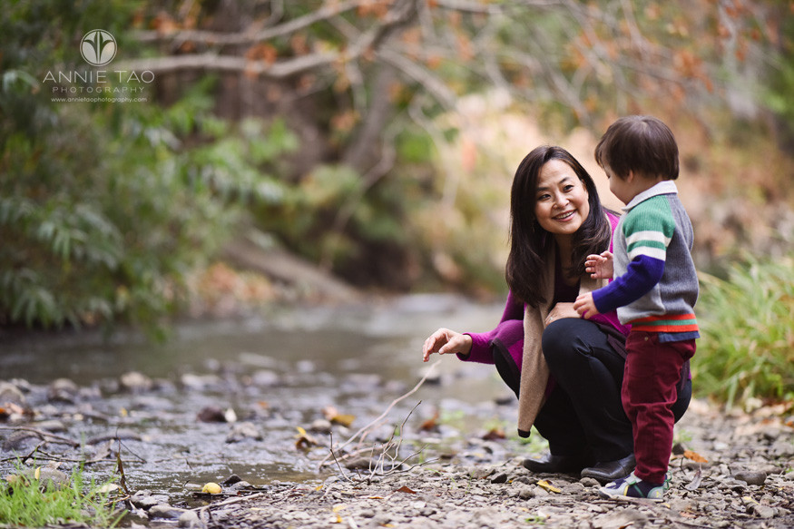 San-Francisco-Bay-Area-lifestyle-family-photography-smiling-mother-helping-young-son-by-creek