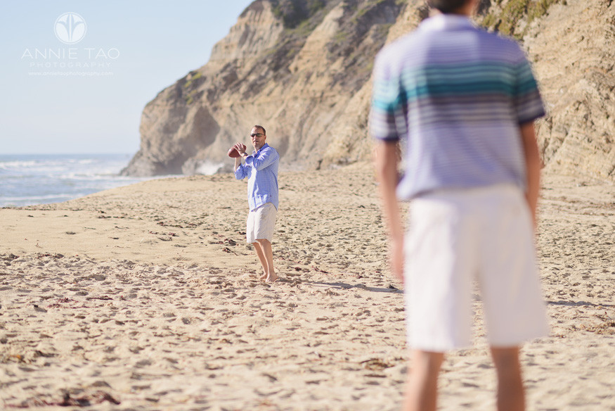 Bay-Area-lifestyle-family-photography-dad-throwing-football-with-son-on-beach