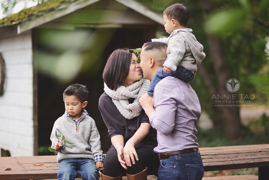 East-Bay-lifestyle-family-photography-toddler-boy-holding-pretend-mistletoe-for-parents