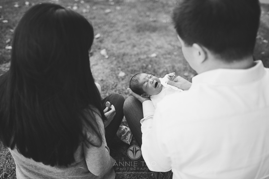 East-Bay-lifestyle-newborn-photography-baby-crying-with-parents-holding-her