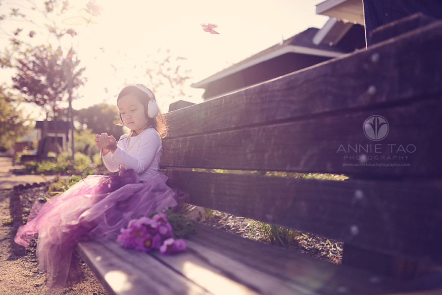 East-Bay-styled-children-photography-preschooler-listening-to-music-with-a-headset-on-a-bench