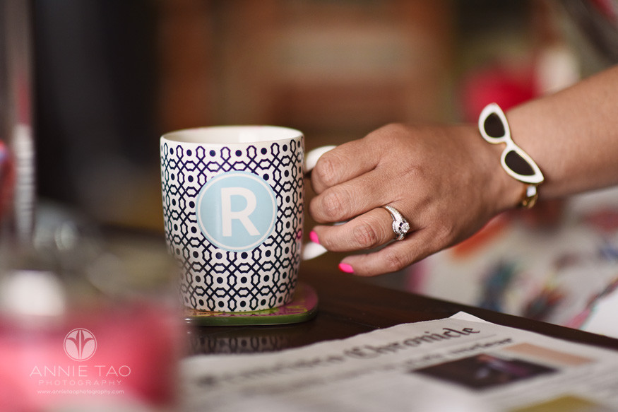 East-Bay-styled-photography-womans-hand-reaching-out-to-mug-in-livingroom
