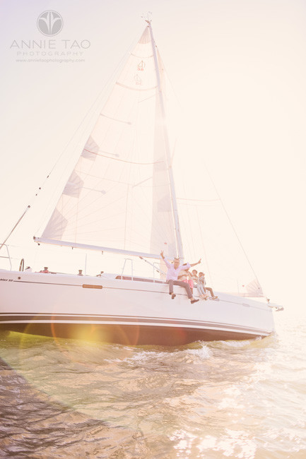 San-Francisco-lifestyle-family-photography-sitting-on-edge-of-sailboat-in-bay