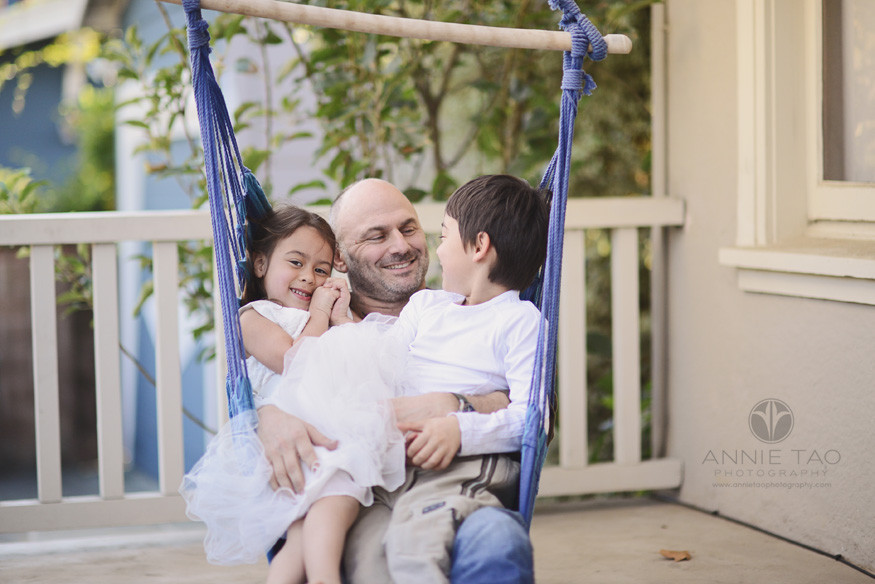 East-Bay-lifestyle-family-photography-father-and-his-children-sitting-in-swing