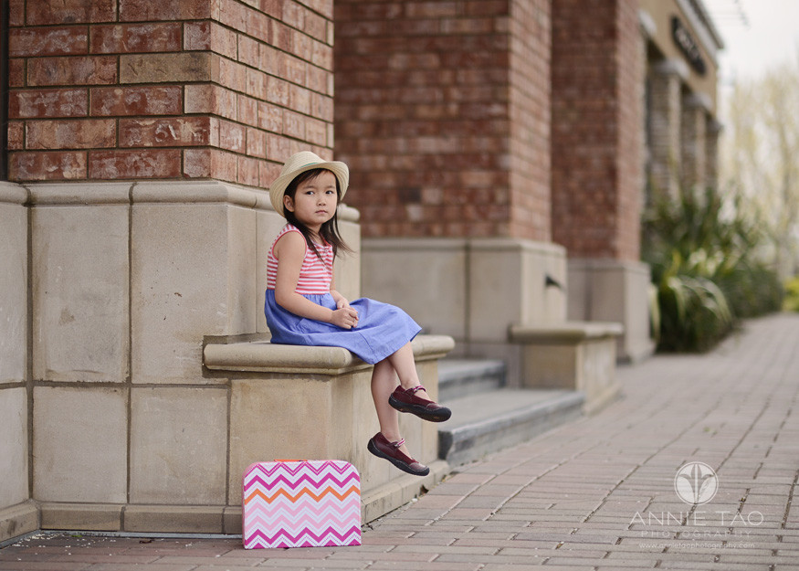 East-Bay-styled-children-photography-preschool-girl-waiting-at-train-station-with-suitcase-2