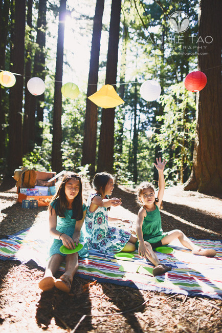 East-Bay-styled-children-photography-three-sisters-sitting-on-blanket-with-eyes-closed-for-game