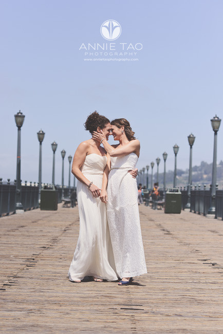 San-Francisco-wedding-photography-gay-wedding-brides-surprise-on-the-pier