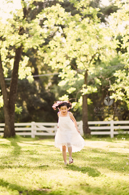 East-Bay-styled-children-photography-young-girl-running-in-long-dress-in-grass