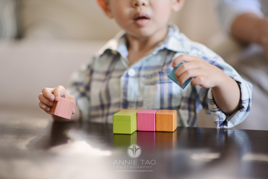 South-Bay-lifestyle-children-photography-toddler-boy-plays-with-wooden-toy-closeup