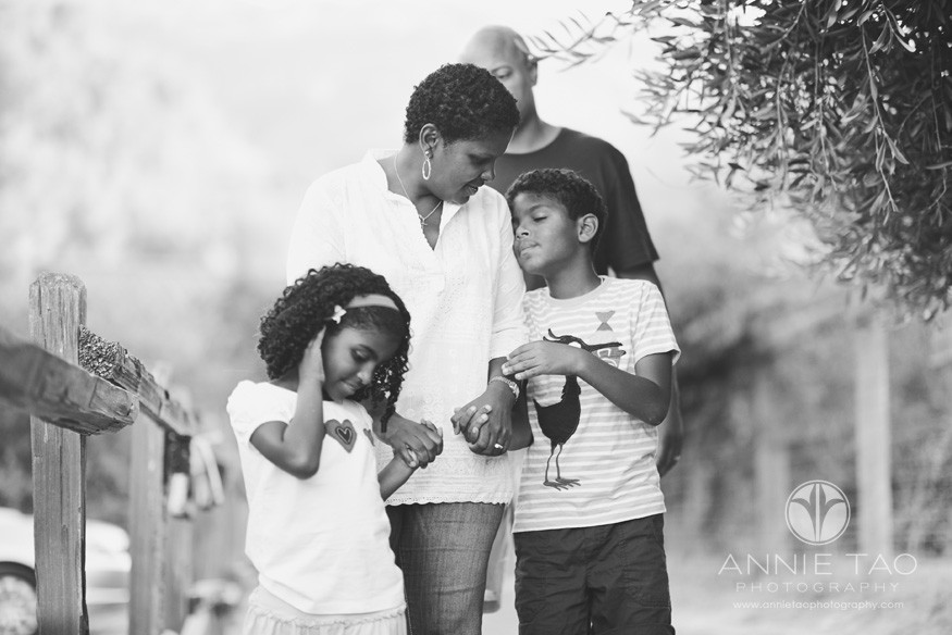 Bay-Area-Los-Altos-lifestyle-family-photography-mom-holding-hands-with-her-children-as-dad-walks-behind-BxW