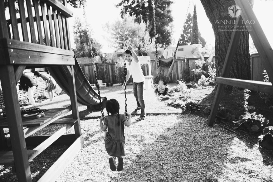 East-Bay-lifestyle-family-photography-father-instructing-youngest-daughter-how-to-swing-in-backyard-BxW