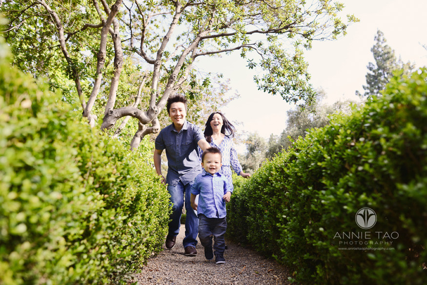 South-Bay-lifestyle-family-photography-parents-running-after-toddler-boy-between-bushes