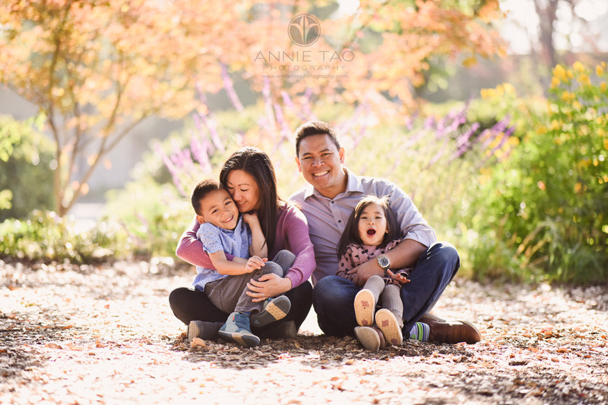 san-francisco-bay-area-lifestyle-family-photography-happy-parents-sitting-and-hugging-children-in-sunshine-in-garden