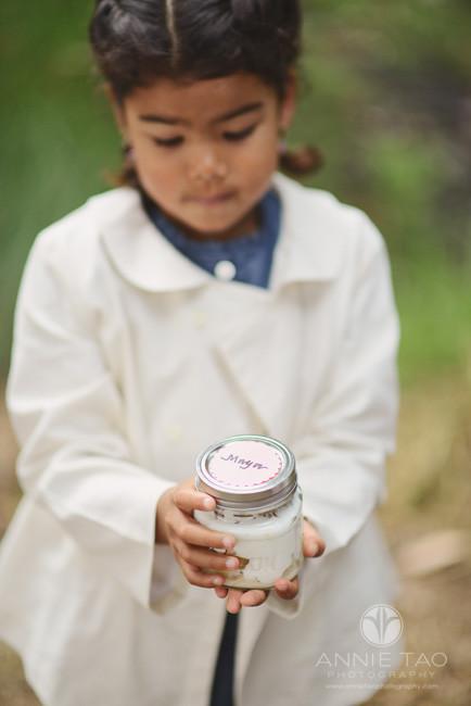 San-Francisco-lifestyle-children-photography-young-girl-holding-mason-jar-with-homemade-yogurt-parfait-breakfast