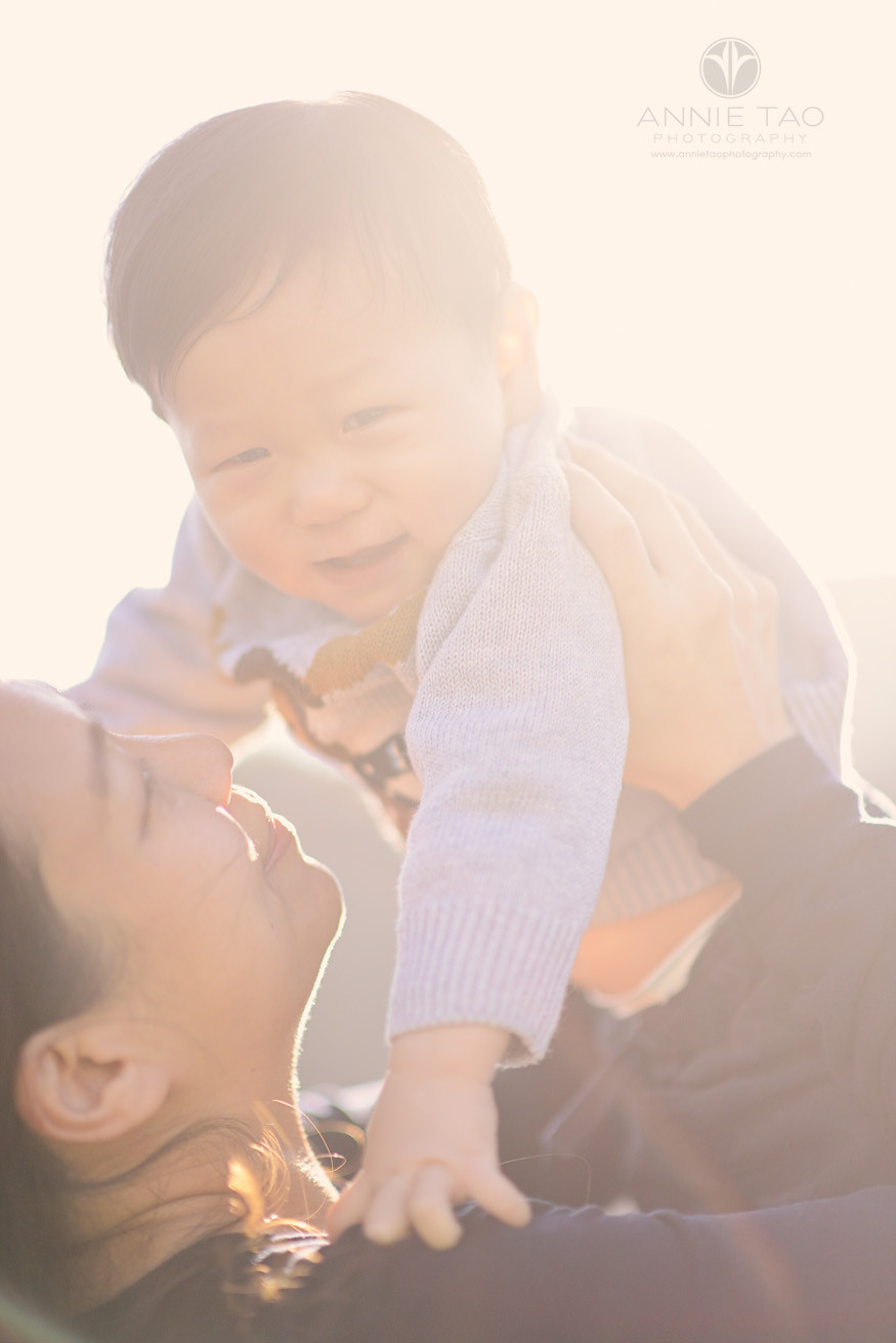 San-Francisco-lifestyle-baby-photography-mom-lifts-baby-with-sunflare-large