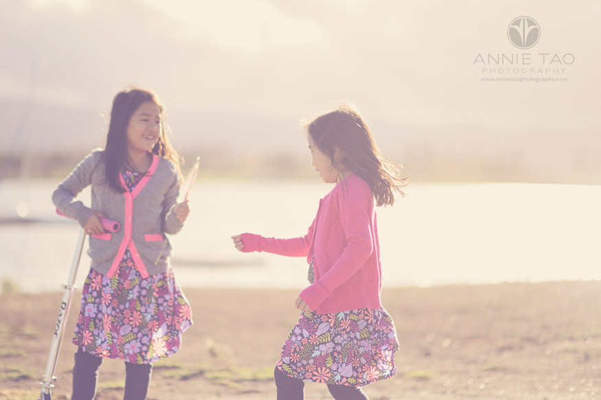 bay-area-lifestyle-children-photography-sisters-playing-with-hazy-sun